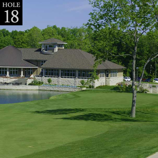 view of hole #18 with clubhouse in the background