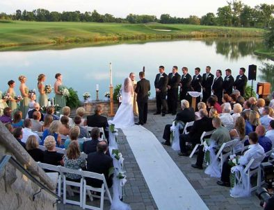wedding vows on the patio overlooking the lake and golf course