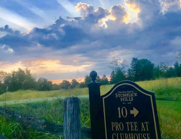 10th tee sign at sunset