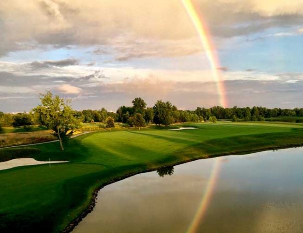 Hole 18 with a rainbow overhead