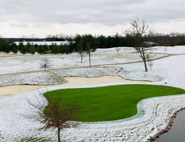 Hole 18 green in winter with snow on the ground