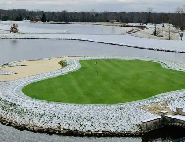 Hole 9 island green in winter with snow on the ground